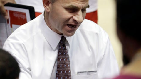 Ball State head coach James Whitford talks to his team during a timeout in the second half of an NCAA college basketball game against Saint Louis Friday, Nov. 11, 2016, in St. Louis. Ball State won 85-64. (AP Photo/Jeff Roberson)
