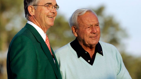 FILE - In this Thursday, April 5, 2007, file photo, Augusta National chairman Billy Payne, left, stands with honorary starter Arnold Palmer before the first round of the 2007 Masters golf tournament at the Augusta National Golf Club in Augusta, Ga. Payne announced Wednesday, Aug. 23, 2017, that he is retiring as chairman of the Augusta National Golf Club. (AP Photo/David J. Phillip, File)