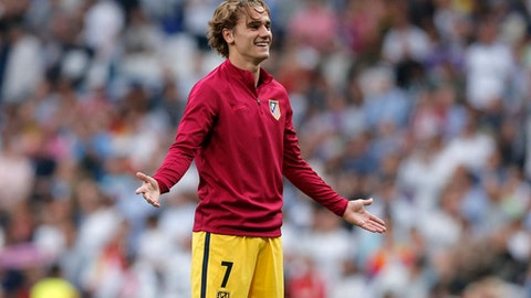 FILE - In this Tuesday May 2, 2017 file photo, Atletico's Antoine Griezmann gestures  before their Champions League semifinals first leg soccer match against Real Madrid at Santiago Bernabeu stadium in Madrid, Spain. Atletico Madrid forward Antoine Griezmann has been suspended for two matches after he used disrespectful language when complaining to a referee about being sent off in the Spanish league. The Spanish football federation's competition committee issued the ban on Wednesday, Aug. 23, 2017. (AP Photo/Daniel Ochoa de Olza, file)