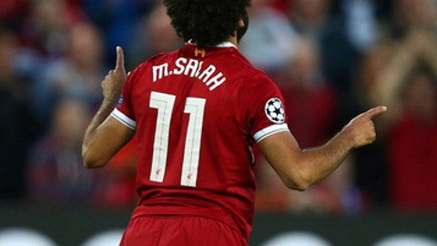 Liverpool's Mohamed Salah celebrates scoring his sides second goal during the Champions League qualifying play-off second leg soccer match between Liverpool and Hoffenheim at Anfield stadium in Liverpool, England, Wednesday, Aug. 23, 2017. (AP Photo/Dave Thompson)