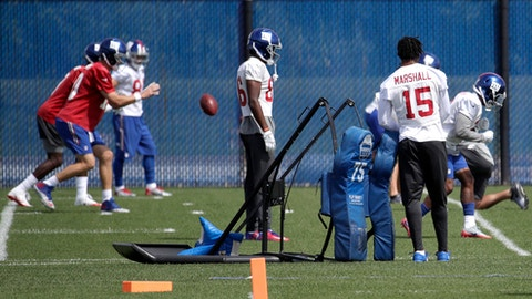 New York Giants wide receiver Brandon Marshall (15) leans on a tackling sled as he watches quarterbacks throw to receivers during drills at NFL football practice, Wednesday, Aug. 23, 2017, in East Rutherford, N.J. (AP Photo/Julio Cortez)