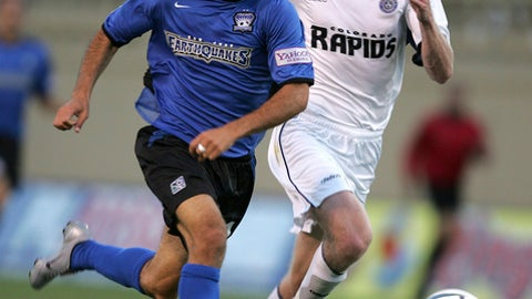 FILE - In this Saturday, Aug. 28, 2004 file photo, San Jose Earthquakes' Landon Donovan, left, breaks ahead of Colorado Rapids' Nat Borchers during the first half of a MLS soccer game in San Jose, Calif.  Of all the rivalries in Major League Soccer, the California Clasico is among the most spirited. Just ask Landon Donovan, who played for both sides during his career. (AP Photo/John Todd, File)