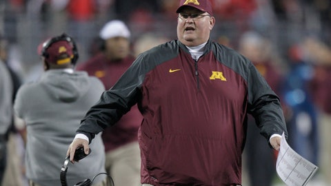 """FILE - In this Nov. 7, 2015, file photo, Minnesota interim coach Tracy Claeys gestures on the sideline during the team's NCAA college football game against Ohio State, in Columbus, Ohio. Former Minnesota coach Claeys is defending himself after an outside review blamed """"weak leadership"""" by the coaching staff for a threat by players to boycott the Holiday Bowl. Claeys wrote a commentary that appeared online Wednesday, Aug. 23, 2017. The review released last week found the university followed law and policy properly when it suspended 10 players last fall following an accusation of sexual assault. (AP Photo/Jay LaPrete, File)"""