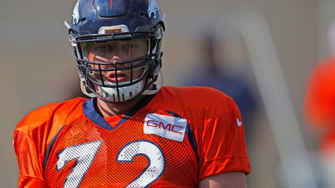 FILE - In this Monday, July 31, 2017, file photograph, Denver Broncos rookie offensive tackle Garett Bolles looks on during drills at an NFL football training camp practice in Englewood, Colo. The Broncos are looking to Bolles, the team's first-round pick in this past spring's NFL Draft, to anchor a revamped offensive line in the regular season ahead. (AP Photo/David Zalubowski, File)
