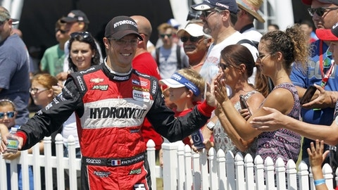 FILE - In this Sunday, July 31, 2016 file photo, Sebastien Bourdais, of France, greets fans during driver introductions for the IndyCar Honda Indy 200 auto race at Mid-Ohio Sports Car Course in Lexington, Ohio.  Sebastien Bourdais will return to IndyCar competition this weekend after a three-month recovery from an accident at Indianapolis Motor Speedway, Wednesday, Aug. 23, 2017. The Frenchman fractured his pelvis and right hip during a crash while qualifying for the Indianapolis 500. A return this season seemed to be a stretch, but Bourdais vowed to race in next month's season finale. (AP Photo/Tom E. Puskar, File)