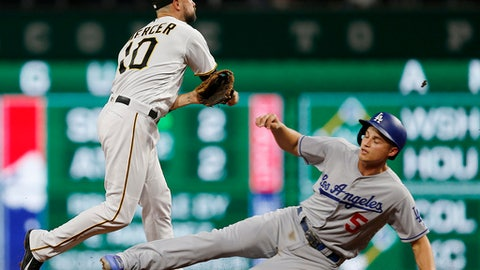 Los Angeles Dodgers' Corey Seager (5) is forced out at second as Pittsburgh Pirates shortstop Jordy Mercer (10) relays the ball on to first to complete the double-play on Curtis Granderson's ground ball in the fifth inning of a baseball game, Wednesday, Aug. 23, 2017, in Pittsburgh. (AP Photo/Keith Srakocic)