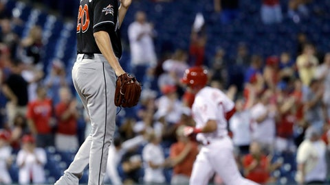 Miami Marlins starting pitcher Justin Nicolino, left, walks the mound after giving up a three-run home run to Philadelphia Phillies' Rhys Hoskins during the third inning of a baseball game, Wednesday, Aug. 23, 2017, in Philadelphia. (AP Photo/Matt Slocum)