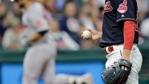 Cleveland Indians starting pitcher Corey Kluber, right, waits for Boston Red Sox's Mitch Moreland to run the bases after Moreland hit a solo home run in the fifth inning of a baseball game, Wednesday, Aug. 23, 2017, in Cleveland. (AP Photo/Tony Dejak)