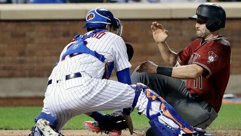 New York Mets catcher Travis d'Arnaud, left, tags out Arizona Diamondbacks' A.J. Pollock, right, during the fifth inning of a baseball game Wednesday, Aug. 23, 2017, in New York. (AP Photo/Frank Franklin II)