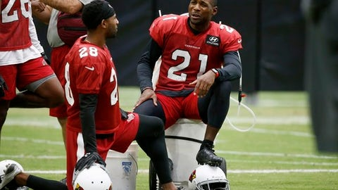 Arizona Cardinals cornerbacks Patrick Peterson (21) and Justin Bethel (28) chat on the sideline during NFL football training camp Wednesday, Aug. 23, 2017, in Glendale, Ariz. (AP Photo/Ross D. Franklin)