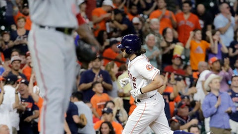 Houston Astros' Jake Marisnick, right, runs the bases after hitting a home run off Washington Nationals starting pitcher Edwin Jackson, left, during the fifth inning of a baseball game Wednesday, Aug. 23, 2017, in Houston. (AP Photo/David J. Phillip)