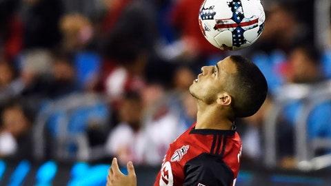 Toronto FC forward Sebastian Giovinco (10) heads the ball during the second half of a MLS soccer game against the Philadelphia Union, Wednesday, Aug. 23, 2017 in Toronto. (Nathan Denette/Canadian Press via AP)