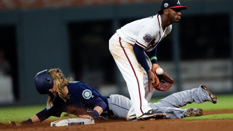 Seattle Mariners' Taylor Motter (21) steals seconds base as Atlanta Braves second baseman Ozzie Albies (1) handles the late throw in the eighth inning of a baseball game Wednesday, Aug. 23, 2017, in Atlanta. (AP Photo/John Bazemore)