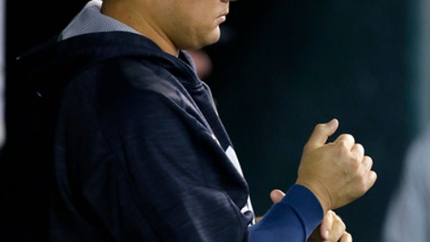 New York Yankees' Masahiro Tanaka watches the Yankees' baseball game against the Detroit Tigers from the dugout during the sixth inning Wednesday, Aug. 23, 2017, in Detroit. (AP Photo/Duane Burleson)
