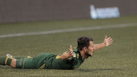 Portland Timbers' Sebastian Blanco calls for a foul, during the team's MLS soccer match against the Colorado Rapids on Wednesday, Aug. 23, 2017, in Portland, Ore. (Sean Meagher/The Oregonian via AP)