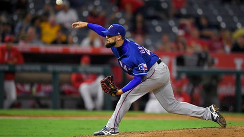 Texas Rangers relief pitcher Tony Barnette throws during the 10th inning of a baseball game against the Los Angeles Angels, Wednesday, Aug. 23, 2017, in Anaheim, Calif. The Rangers won 7-5 in 10 innings. (AP Photo/Mark J. Terrill)