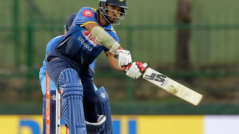Sri Lanka's Milinda Siriwardana plays a shot during their second one-day international cricket match against India in Pallekele, Sri Lanka, Thursday, Aug. 24, 2017. (AP Photo/Eranga Jayawardena)