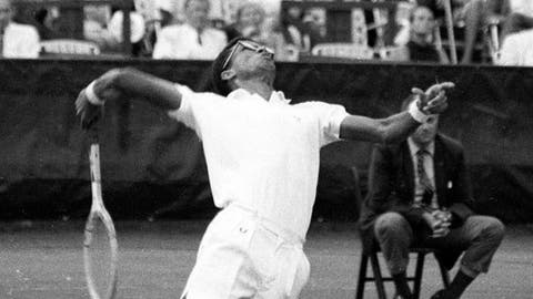 File-This Sept. 9, 1968, file photo shows Arthur Ashe in action during the inaugural U.S. Open Tennis Championship at Forest Hills in Queens, New York City. (AP Photo/ File)