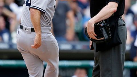 New York Yankees manager Joe Girardi kicks the dirt while arguing with home plate umpire Carlos Torres after Yankees pitcher Tommy Kahnle was ejected during the sixth inning of a baseball game against the Detroit Tigers Thursday, Aug. 24, 2017, in Detroit. Torres ejected Girardi moments later. (AP Photo/Duane Burleson)