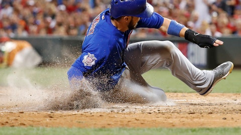 Chicago Cubs' Kris Bryant scores on an RBI single from Javier Baez off Cincinnati Reds starting pitcher Sal Romano during the sixth inning of a baseball game, Thursday, Aug. 24, 2017, in Cincinnati. (AP Photo/John Minchillo)