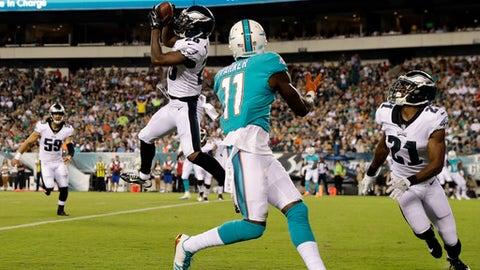 Philadelphia Eagles' Jaylen Watkins (26) pulls in an interception against Miami Dolphins' DeVante Parker (11) during the first half of a preseason NFL football game, Thursday, Aug. 24, 2017, in Philadelphia. (AP Photo/Michael Perez)