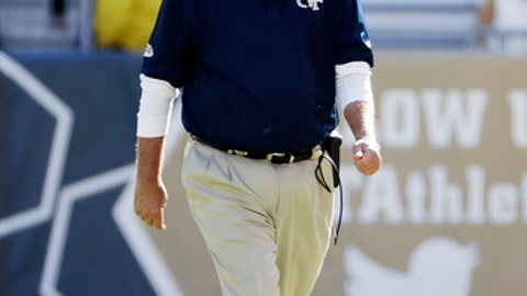 File-This Nov. 19, 2016, file photo shows Georgia Tech head coach Paul Johnson walking on the sideline during an NCAA college football game in Atlanta. Georgia Tech may turn to running back-by-committee to fill the void created after  Johnson dismissed leading rusher Dedrick Mills last week. Redshirt sophomore KirVonte Benson is healthy and appears to be the favorite to start when the Yellow Jackets open the season against Tennessee on Sept. 4 in Mercedes-Benz Stadium. but Johnson said four backs will dress for the opener.(AP Photo/David Goldman, File)