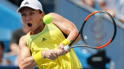 File- This Aug. 20, 2017, file photo shows Simona Halep, of Romania, returning to Garbine Muguruza, of Spain, during the women's singles final at the Western & Southern Open in Mason, Ohio. The draw announced Friday, Aug. 25, 2017, has the two-time French Open runner-up Halep facing Maria Sharapova in her first Grand Slam match in more than 1½ years.  (AP Photo/John Minchillo, File)
