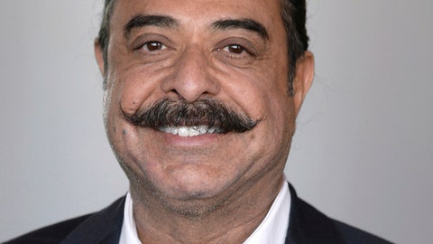 """This is a photo of Jacksonville Jaguars owner Shad Khan. Khan says he would be open to signing free-agent quarterback Colin Kaepernick. Speaking to the team's flagship radio station, Khan responded """"absolutely"""" when asked Thursday, Aug. 24, 2017, whether he would support signing Kaepernick if the team's front office wanted to do it. Khan's comments were not recorded, just relayed via Twitter. (AP Photo)"""