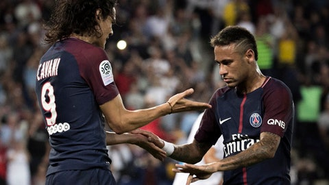 PSG's Edinson Cavani, left, reacts with teammate Neymar after a goal was scored, during the French League One soccer match between Paris Saint Germain and Saint Etienne at the Parc des Princes stadium in Paris, France, Friday, Aug. 25, 2017. (AP Photo/Kamil Zihnioglu)
