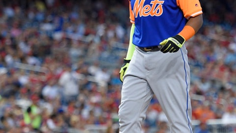 New York Mets' Yoenis Cespedes reacts during the first inning of a baseball game against the Washington Nationals, Friday, Aug. 25, 2017, in Washington. Cespedes left the game with an injury. (AP Photo/Nick Wass)