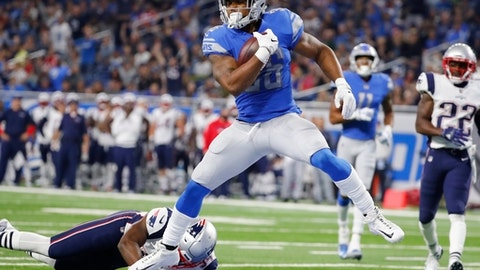 Detroit Lions running back Dwayne Washington (36) leaps into the end zone for an 18-yard rushing touchdown during the second half of an NFL preseason football game against the New England Patriots, Friday, Aug. 25, 2017, in Detroit. (AP Photo/Rick Osentoski)