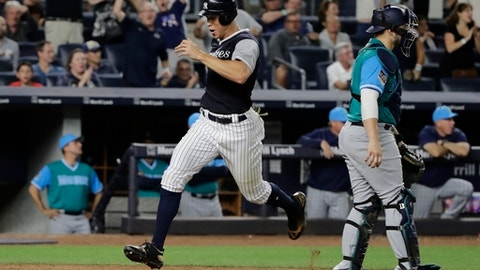 New York Yankees' Aaron Judge scores past Seattle Mariners catcher Mike Zunino on a double by Didi Gregorius during the eighth inning of a baseball game Friday, Aug. 25, 2017, in New York. (AP Photo/Frank Franklin II)