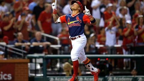St. Louis Cardinals' Kolten Wong gestures skyward as he runs to home plate after hitting a solo home run during the fourth inning of a baseball game against the Tampa Bay Rays on Friday, Aug. 25, 2017, in St. Louis. (AP Photo/Scott Kane)
