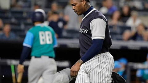New York Yankees relief pitcher Aroldis Chapman leaves the field during the 11th inning of a baseball game against the Seattle Mariners on Friday, Aug. 25, 2017, in New York. (AP Photo/Frank Franklin II)