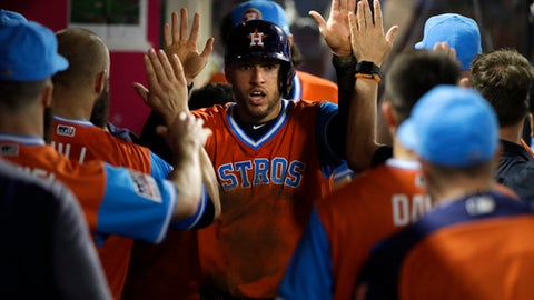 Davis' home run, wild pitch lead Astros past Angels 2-1