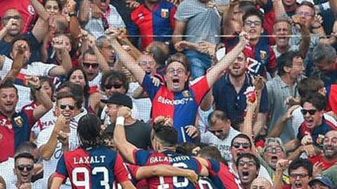Genoa players celebrate after Juventus' Miralem Pjanic scored an own goal, during a Serie A soccer match between Genoa and Juventus, at the Luigi Ferraris Stadium in Genoa, Italy, Saturday, Aug. 26, 2017. (Simone Arveda/ANSA via AP)