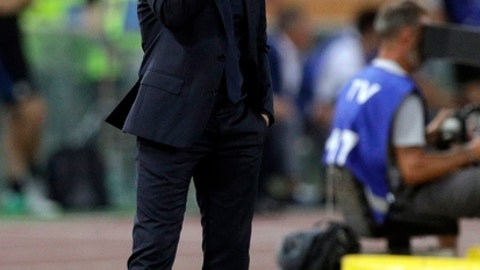 Roma coach Eusebio Di Francesco adjusts his glasses during a Serie A soccer match between Roma and Inter Milan, at the Rome Olympic Stadium, Saturday, Aug. 26, 2017 (AP Photo/Andrew Medichini)