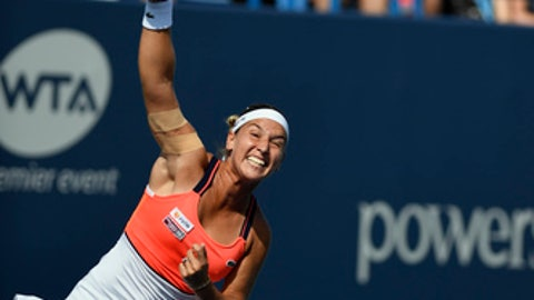 Dominika Cibulkova of Slovakia serves against Daria Gavrilova of Australia, during the first set in the final match of the Connecticut Open tennis tournament in New Haven, Conn., on Saturday, Aug. 26, 2017. (AP Photo/Jessica Hill)
