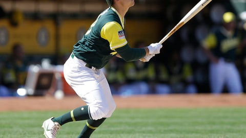 Oakland Athletics' Chad Pinder runs out a pop fly out in the sixth inning of a baseball game against the Texas Rangers Saturday, Aug. 26, 2017, in Oakland, Calif. (AP Photo/Ben Margot)