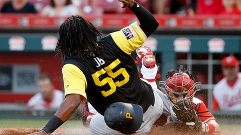 Pittsburgh Pirates' Josh Bell (55) is tagged out at home by Cincinnati Reds catcher Tucker Barnhart, right, during the fourth inning of a baseball game, Saturday, Aug. 26, 2017, in Cincinnati. (AP Photo/John Minchillo)