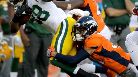 Green Bay Packers running back Ty Montgomery (88) is hit by Denver Broncos strong safety Justin Simmons during the first half of an NFL preseason football game, Saturday, Aug. 26, 2017, in Denver. AP Photo/Jack Dempsey)