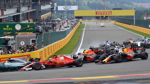 Mercedes driver Lewis Hamilton of Britain, left, leads Ferrari driver Kimi Raikkonen of Finland, second left, into the first corner during the start of the Belgian Formula One Grand Prix in Spa-Francorchamps, Belgium, Sunday, Aug. 27, 2017. (AP Photo/Geert Vanden Wijngaert)