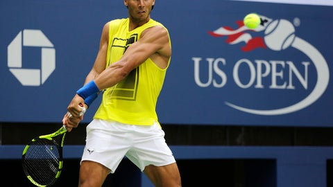 Rafael Nadal, of Spain, returns a shot during practice at the U.S. Open tennis tournament on Sunday, Aug. 27, 2017, in New York. The competition starts on Monday. (AP Photo Peter Morgan)