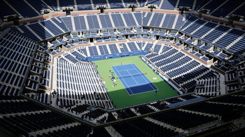 Players practice at the empty Arthur Ashe Stadium at the U.S. Open tennis tournament on Sunday, Aug. 27, 2017, in New York. The competition starts on Monday. (AP Photo Peter Morgan)