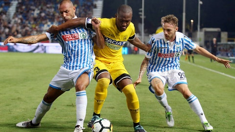 Spal's Pasquale Schiattarella, left, and Manuel Lazzari challenge Udinese's De Souza, center, during a Serie A soccer match at the Paolo Mazza Stadium in Ferrara, Italy, Sunday, aug. 27, 2017. (Serena Campanini/ANSA via AP)