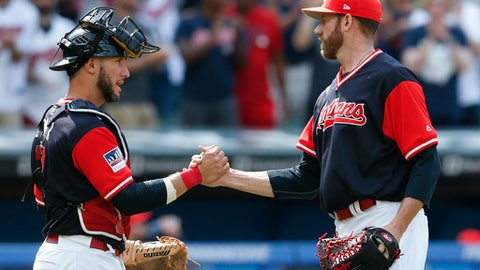 Cleveland Indians' Yan Gomes, left, and Zach McAllister celebrate their victory over the Kansas City Royals in a baseball game, Sunday, Aug. 27, 2017, in Cleveland. (AP Photo/Ron Schwane)