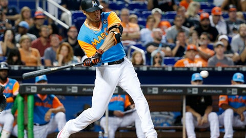 Miami Marlins' Giancarlo Stanton hits a home run during the eighth inning of a baseball game against the San Diego Padres, Sunday, Aug. 27, 2017, in Miami. Stanton hit his 50th home run to break an eighth-inning tie, helping the Marlins sweep the Padres 6-2. (AP Photo/Wilfredo Lee)