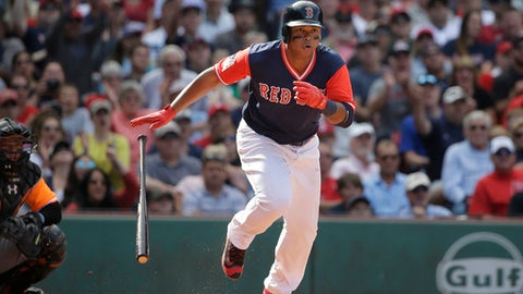 Boston Red Sox's Rafael Devers, right, runs after hitting an RBI double off a pitch by Baltimore Orioles' Mychal Givens as Orioles' Welington Castillo, left, looks on in the sixth inning of a baseball game, Sunday, Aug. 27, 2017, in Boston. (AP Photo/Steven Senne)
