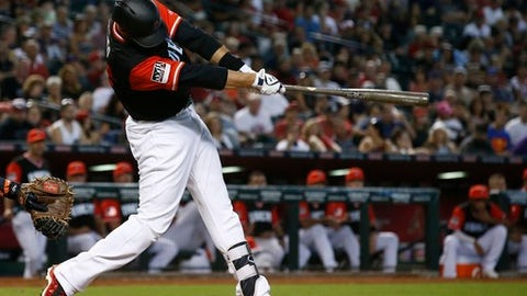 Arizona Diamondbacks' J.D. Martinez connects for a home run against the San Francisco Giants during the sixth inning of a baseball game, Sunday, Aug. 27, 2017, in Phoenix. (AP Photo/Ross D. Franklin)