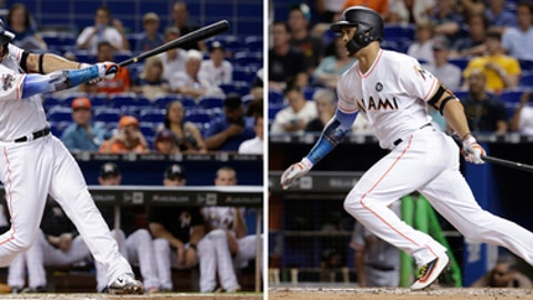 FILE - In these file photos, at left, Miami Marlins' Giancarlo Stanton hits a single against the San Francisco Giants during the first inning of a baseball game Tuesday, Aug. 15, 2017, in Miami and at right, Stanton singles against the Giants during the fourth inning Monday, Aug. 14, 2017 in Miami. While on a home run binge, Stanton is also smacking singles at the best rate of his career. (AP Photo/Lynne Sladky, File)